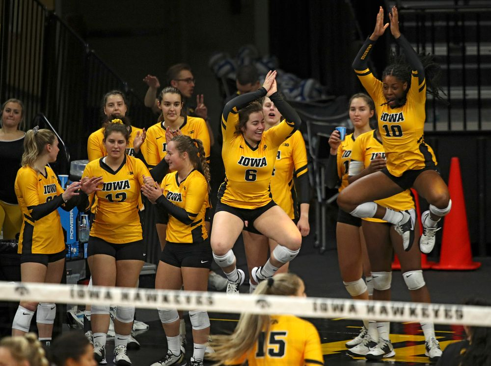 Iowa's Emma Lowes (6) and Griere Hughes (10) celebrate during their match at Carver-Hawkeye Arena in Iowa City on Sunday, Oct 20, 2019. (Stephen Mally/hawkeyesports.com)