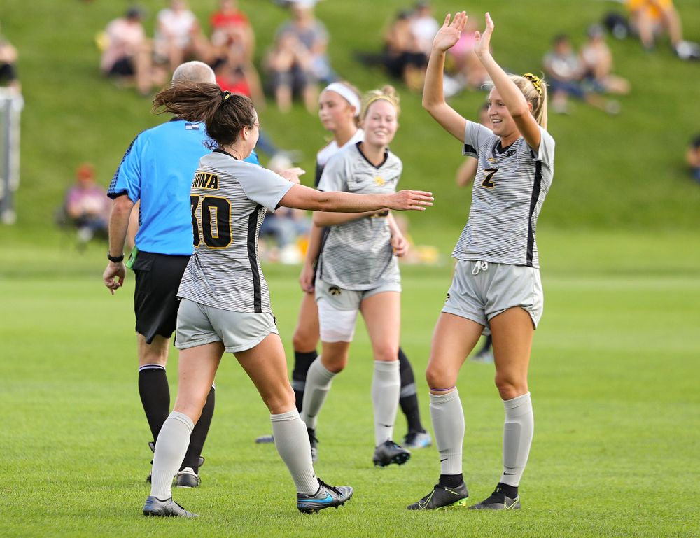 Iowa forward Devin Burns (30) celebrates with midfielder Hailey Rydberg (2) after Burns scored a goal during the first half of their match at the Iowa Soccer Complex in Iowa City on Sunday, Sep 1, 2019. (Stephen Mally/hawkeyesports.com)