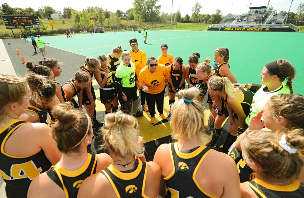 Iowa head coach Lisa Cellucci talks with her team before the start of their match at Grant Field in Iowa City on Friday, Oct 4, 2019. (Stephen Mally/hawkeyesports.com)