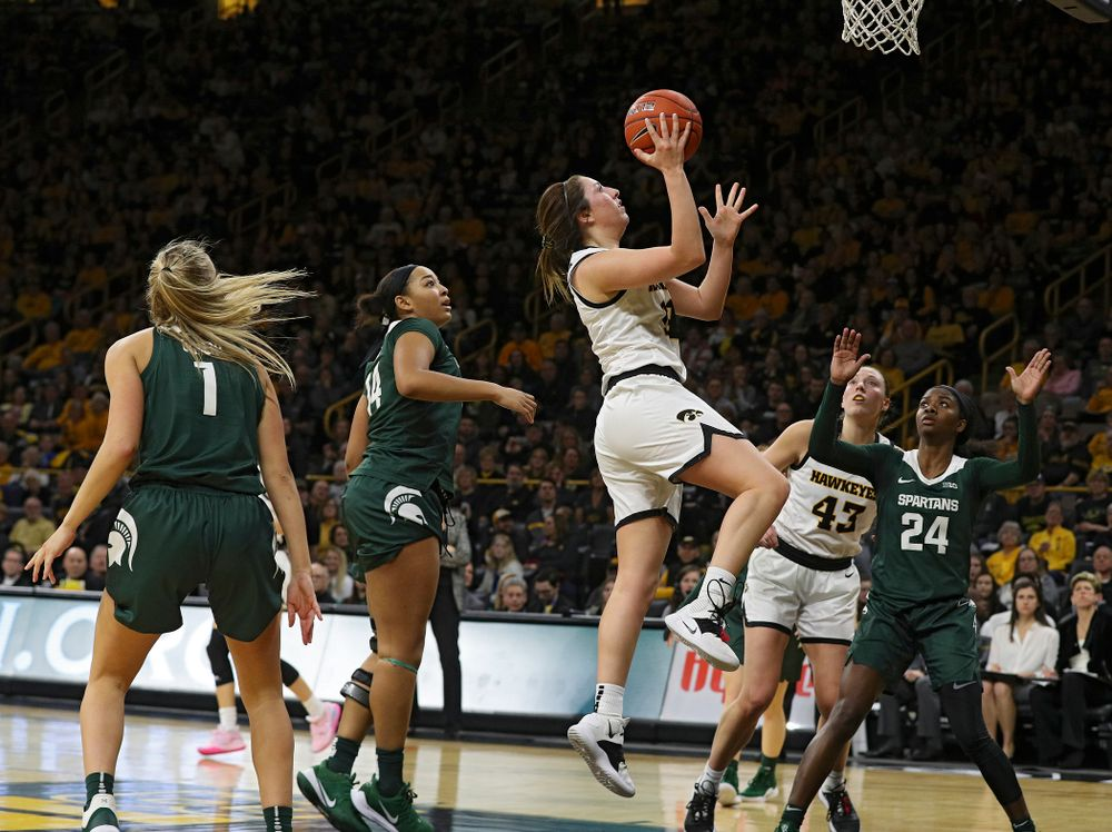Iowa Hawkeyes guard Gabbie Marshall (24) makes a basket during the fourth quarter of their game at Carver-Hawkeye Arena in Iowa City on Sunday, January 26, 2020. (Stephen Mally/hawkeyesports.com)