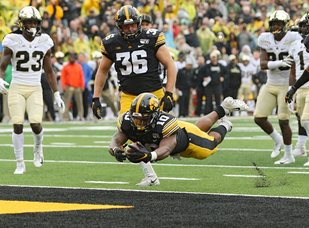 Iowa Hawkeyes running back Mekhi Sargent (10) dives into the end zone on a touchdown run during the fourth quarter of their game at Kinnick Stadium in Iowa City on Saturday, Oct 19, 2019. (Stephen Mally/hawkeyesports.com)