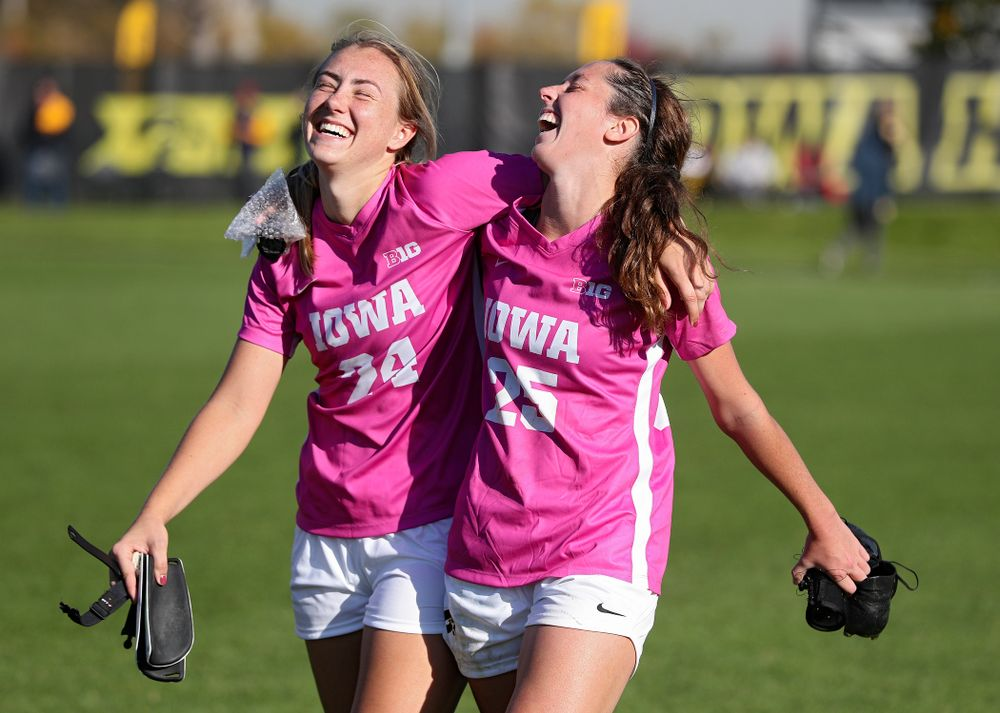 Iowa defender Sara Wheaton (24) and midfielder Josie Durr (25) are all smiles after winning their match in double overtime at the Iowa Soccer Complex in Iowa City on Sunday, Oct 27, 2019. (Stephen Mally/hawkeyesports.com)