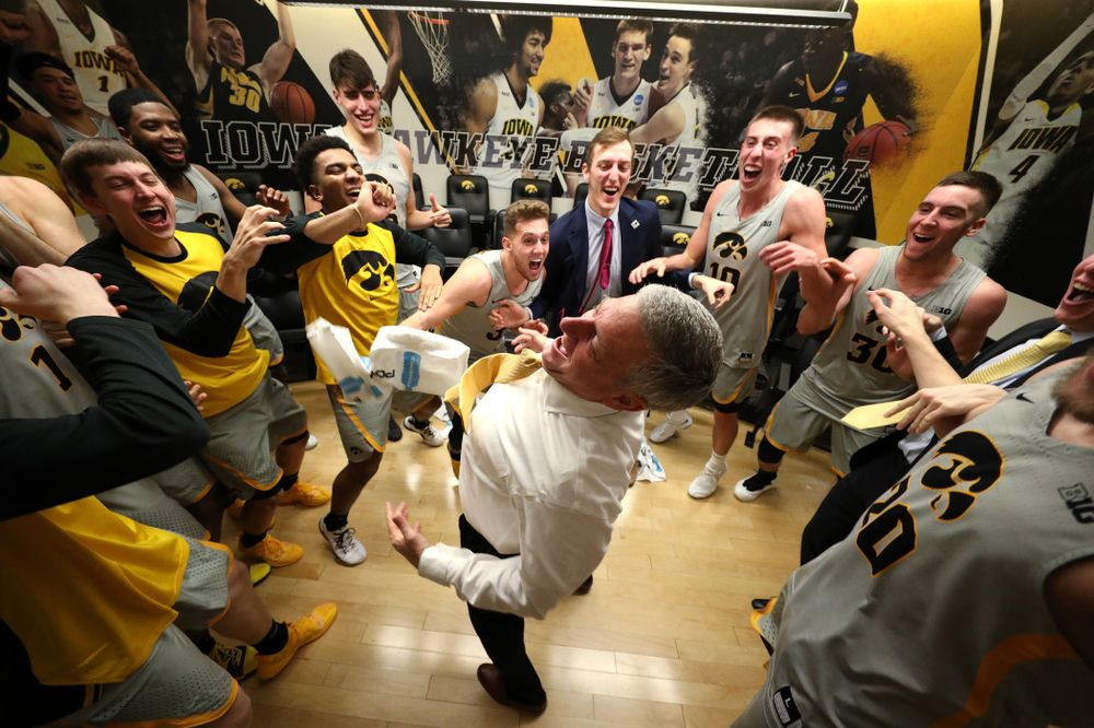 Iowa Hawkeyes assistant coach Kirk Speraw dances with the team following their win against the Iowa State Cyclones in the Iowa Corn Cy-Hawk Series Thursday, December 6, 2018 at Carver-Hawkeye Arena. (Brian Ray/hawkeyesports.com)