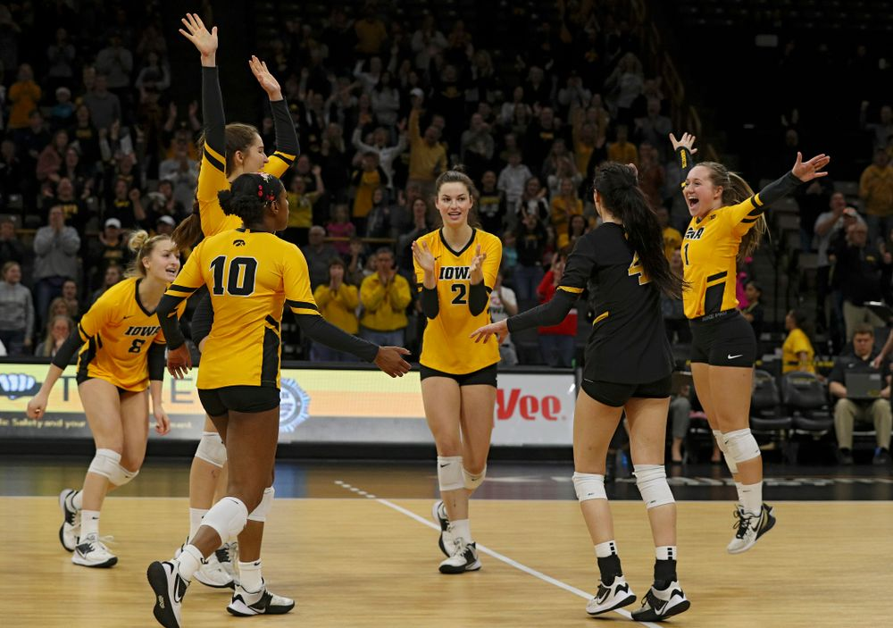 Iowa's Kyndra Hansen (8), Blythe Rients (11), Griere Hughes (10), Courtney Buzzerio (2), Halle Johnston (4), and Joslyn Boyer (1) celebrate after winning the first set of their match at Carver-Hawkeye Arena in Iowa City on Friday, Nov 29, 2019. (Stephen Mally/hawkeyesports.com)