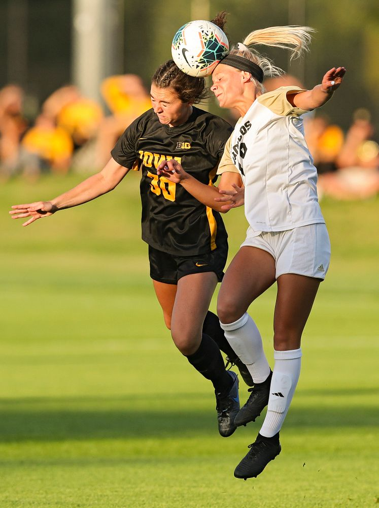 Iowa forward Devin Burns (30) battles for a header during the first half of their match against Western Michigan at the Iowa Soccer Complex in Iowa City on Thursday, Aug 22, 2019. (Stephen Mally/hawkeyesports.com)