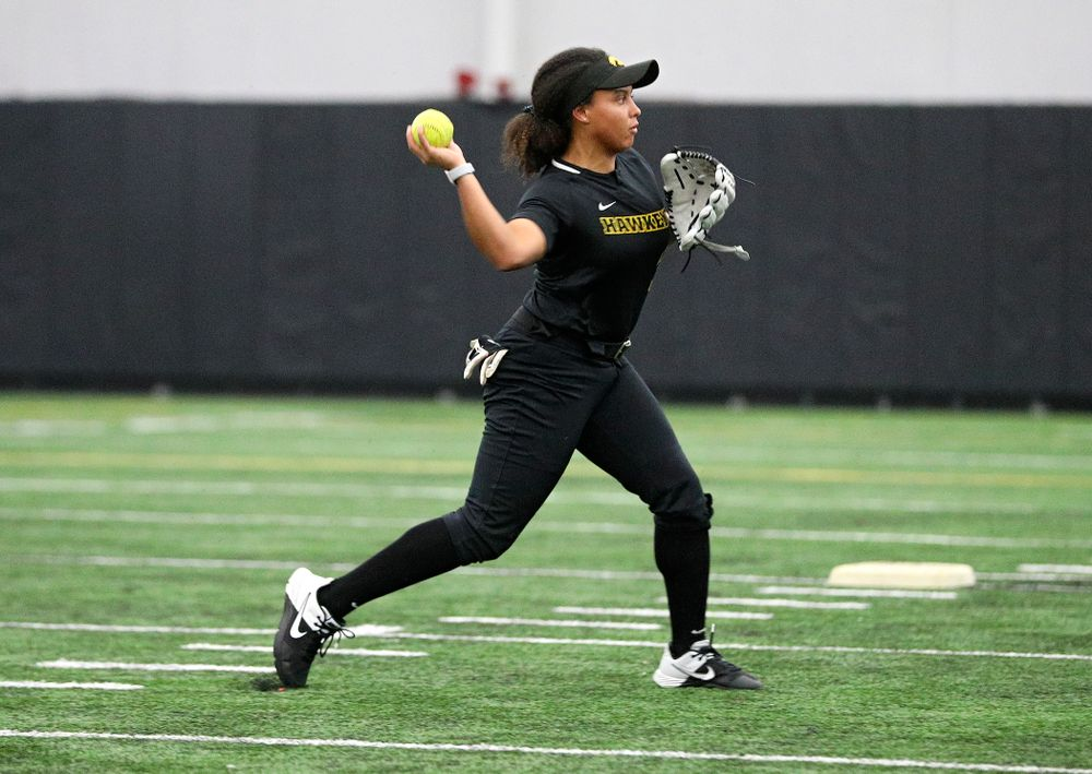 Iowa infielder Avery Guy (11) throws to first as they run a drill during Iowa Softball Media Day at the Hawkeye Tennis and Recreation Complex in Iowa City on Thursday, January 30, 2020. (Stephen Mally/hawkeyesports.com)