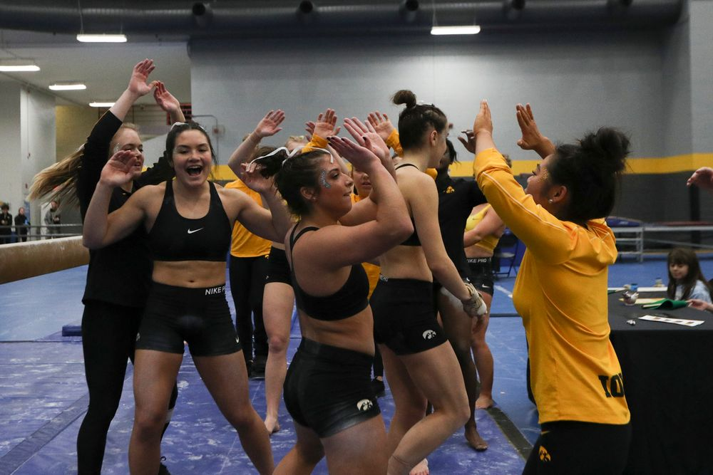 Ariana Agrapides (center) high fives teammates during the Iowa women's gymnastics Black and Gold Intraquad Meet on Saturday, December 7, 2019 at the UI Field House. (Lily Smith/hawkeyesports.com)