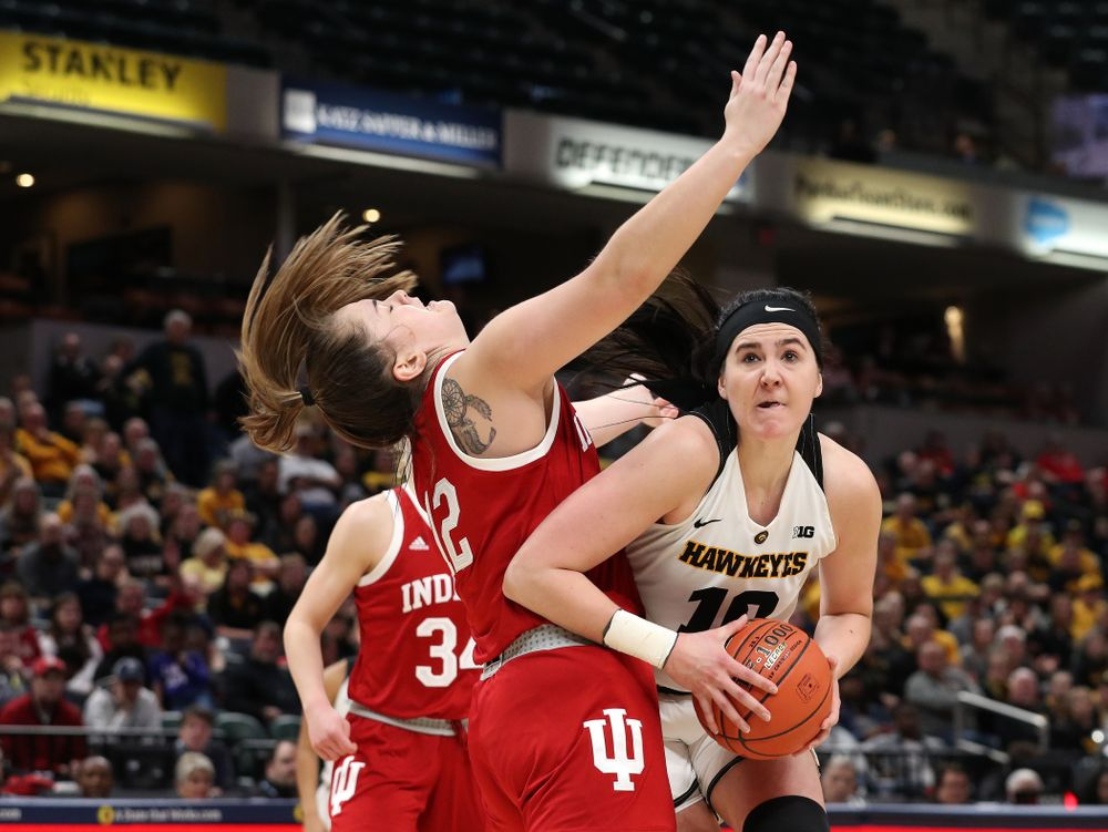 Iowa Hawkeyes forward Megan Gustafson (10) draws a foul on her way to making a basket against the Indiana Hoosiers in the quarterfinals of the Big Ten Tournament Friday, March 8, 2019 at Bankers Life Fieldhouse in Indianapolis, Ind. (Brian Ray/hawkeyesports.com)