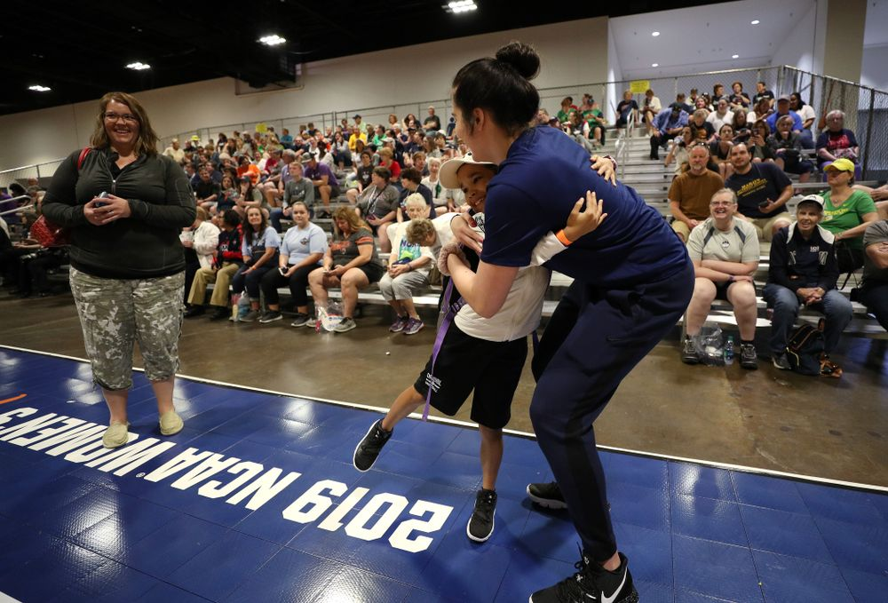 Iowa Hawkeyes forward Megan Gustafson (10) hugs a young fan at the Tourney Town Fan Fest Friday, April 5, 2019 at the Tampa Convention Center in Tampa, FL. (Brian Ray/hawkeyesports.com)