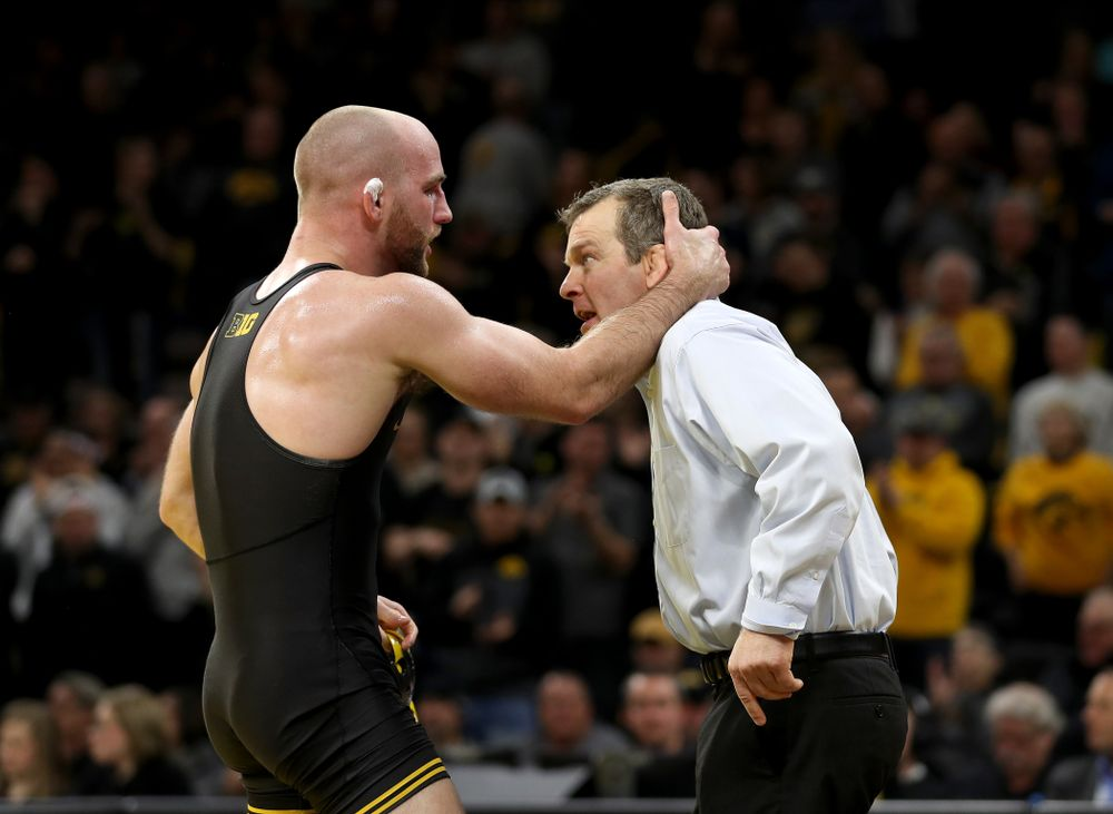 Iowa's Alex Marinelli hugs head coach Tom Brands after defeating Nebraska's Isaiah White at 165 pounds Saturday, January 18, 2020 at Carver-Hawkeye Arena. Marinelli won the match 4-3. (Brian Ray/hawkeyesports.com)
