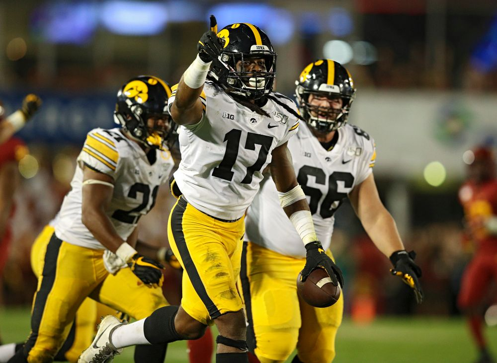Iowa Hawkeyes defensive back Devonte Young (17) celebrates his fumble recovery with running back Ivory Kelly-Martin (21) and defensive lineman Dalles Jacobus (66) during the fourth quarter of their Iowa Corn Cy-Hawk Series game at Jack Trice Stadium in Ames on Saturday, Sep 14, 2019. (Stephen Mally/hawkeyesports.com)