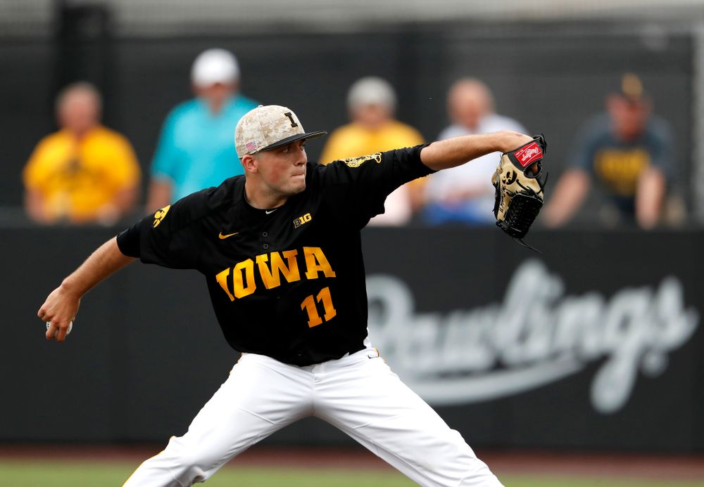 Iowa Hawkeyes pitcher Cole McDonald (11) delivers the ball to the plate against the Penn State Nittany Lions Friday, May 18, 2018 at Duane Banks Field. (Brian Ray/hawkeyesports.com)