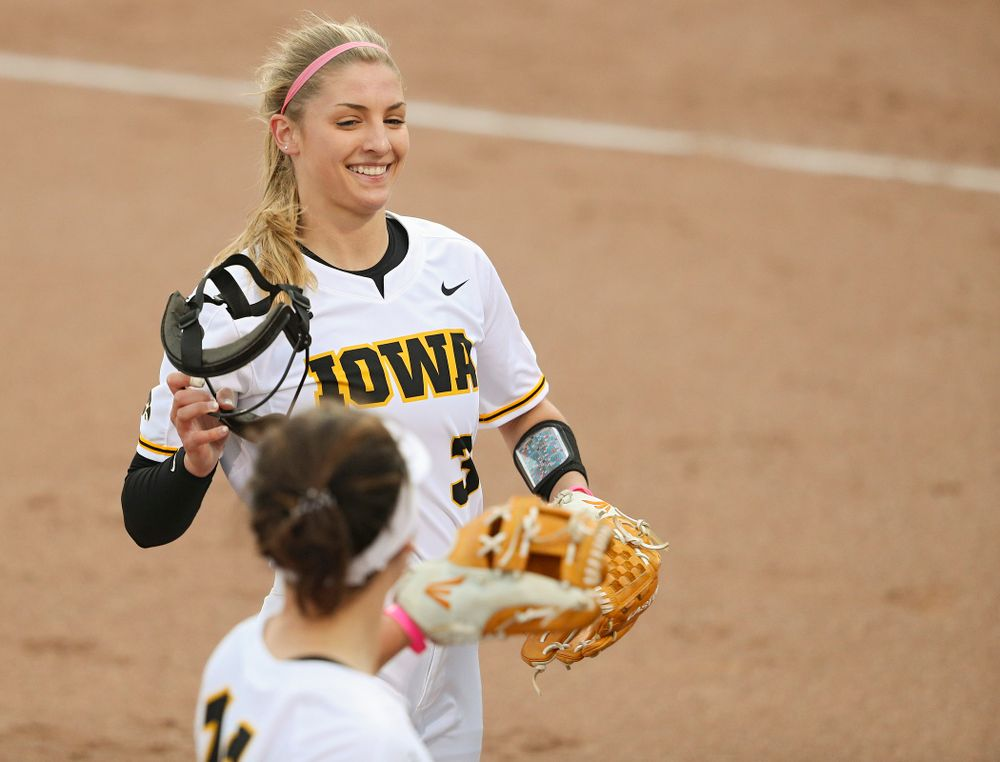 Iowa pitcher Allison Doocy (3) is greeted by third baseman Mallory Kilian (11) after a strikeout to end the top of the second inning of their game against Iowa State at Pearl Field in Iowa City on Tuesday, Apr. 9, 2019. (Stephen Mally/hawkeyesports.com)