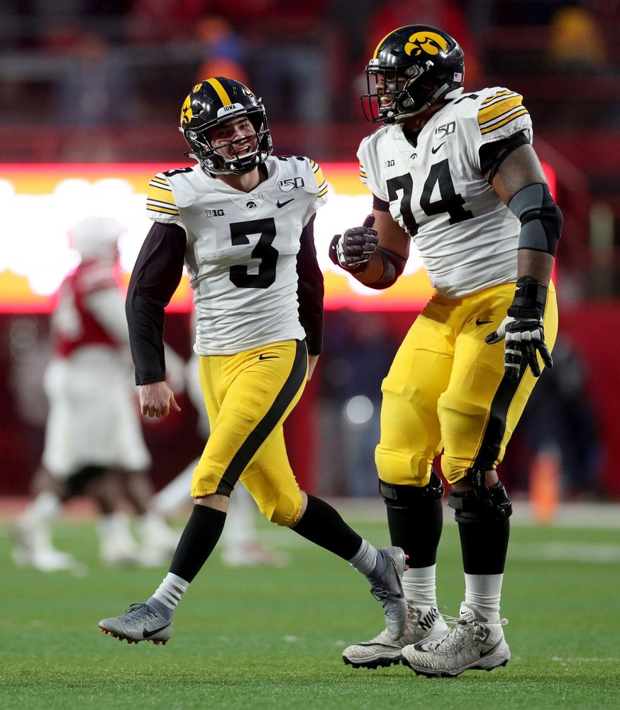 Iowa Hawkeyes place kicker Keith Duncan (3) celebrates with offensive lineman Tristan Wirfs (74) after kicking the game winning field goal against the Nebraska Cornhuskers Friday, November 29, 2019 at Memorial Stadium in Lincoln, Neb. (Brian Ray/hawkeyesports.com)