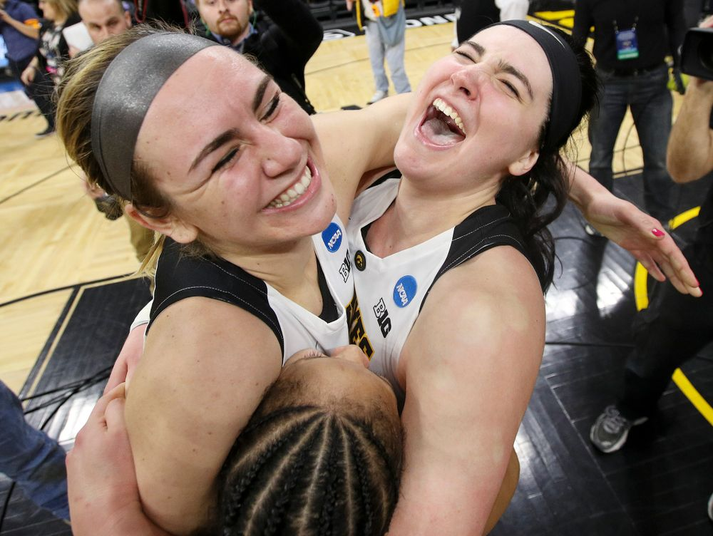 Iowa Hawkeyes forward Hannah Stewart (21), guard Tania Davis (11), and center Megan Gustafson (10) hug after winning their second round game in the 2019 NCAA Women's Basketball Tournament at Carver Hawkeye Arena in Iowa City on Sunday, Mar. 24, 2019. (Stephen Mally for hawkeyesports.com)