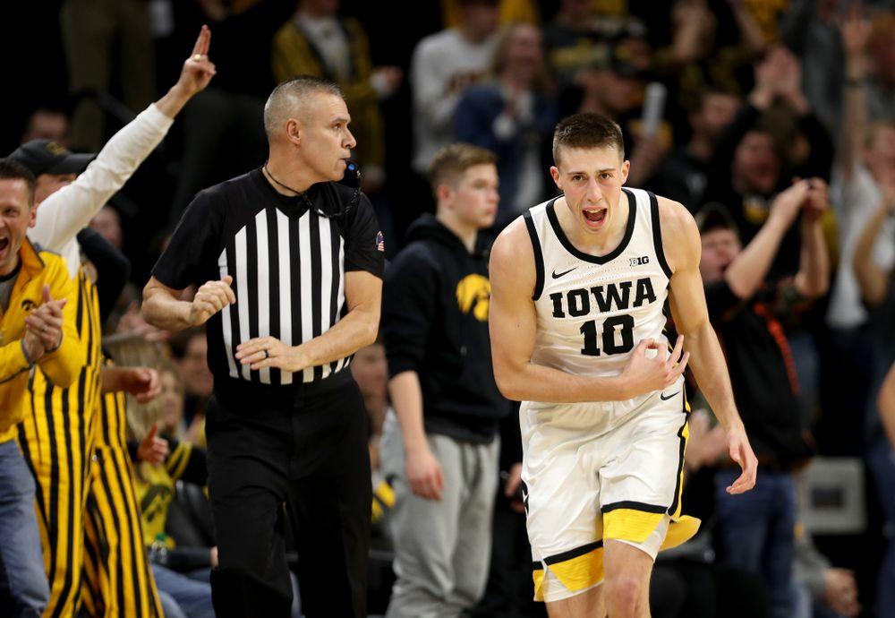 Iowa Hawkeyes guard Joe Wieskamp (10) celebrates a three point basket against the Michigan Wolverines Friday, January 17, 2020 at Carver-Hawkeye Arena. (Brian Ray/hawkeyesports.com)