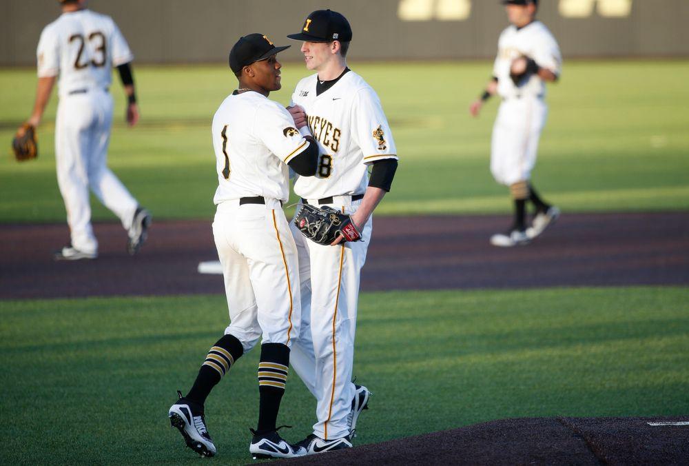 Iowa Hawkeyes infielder Lorenzo Elion (1), Iowa Hawkeyes pitcher Shane Ritter (18)
