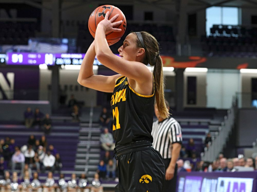 Iowa Hawkeyes guard Megan Meyer (11) makes a 3-pointer during the fourth quarter of their game at Welsh-Ryan Arena in Evanston, Ill. on Sunday, January 5, 2020. (Stephen Mally/hawkeyesports.com)