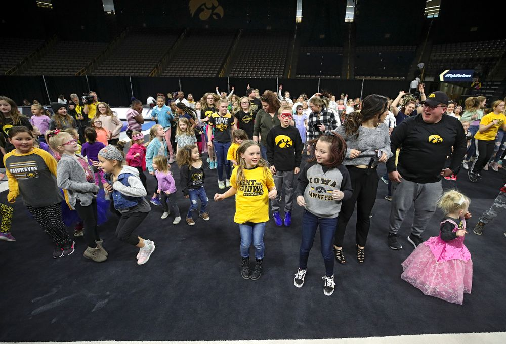 Fans dance the Cha-Cha Slide after the meet at Carver-Hawkeye Arena in Iowa City on Sunday, March 8, 2020. (Stephen Mally/hawkeyesports.com)