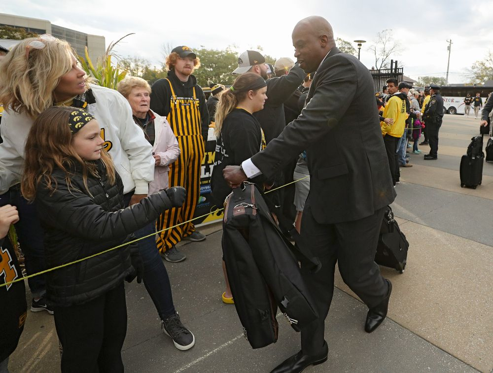 Iowa Hawkeyes wide receivers coach Kelton Copeland greets fans as he arrives with his team before their game at Kinnick Stadium in Iowa City on Saturday, Oct 19, 2019. (Stephen Mally/hawkeyesports.com)