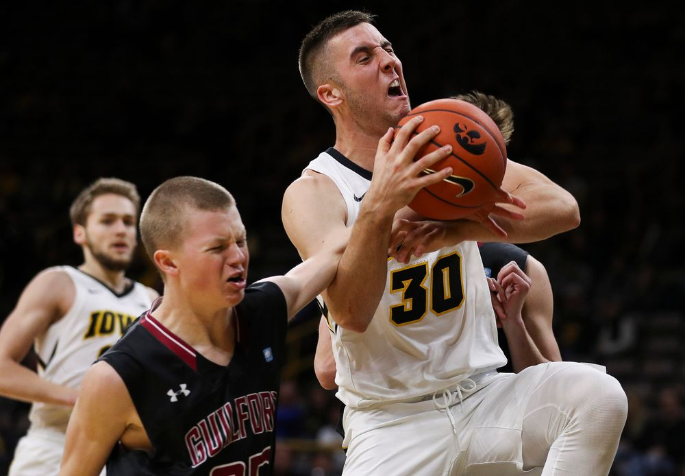 Iowa Hawkeyes guard Connor McCaffery (30) is intentionally fouled on his way to the rim during a game against Guilford College at Carver-Hawkeye Arena on November 4, 2018. (Tork Mason/hawkeyesports.com)
