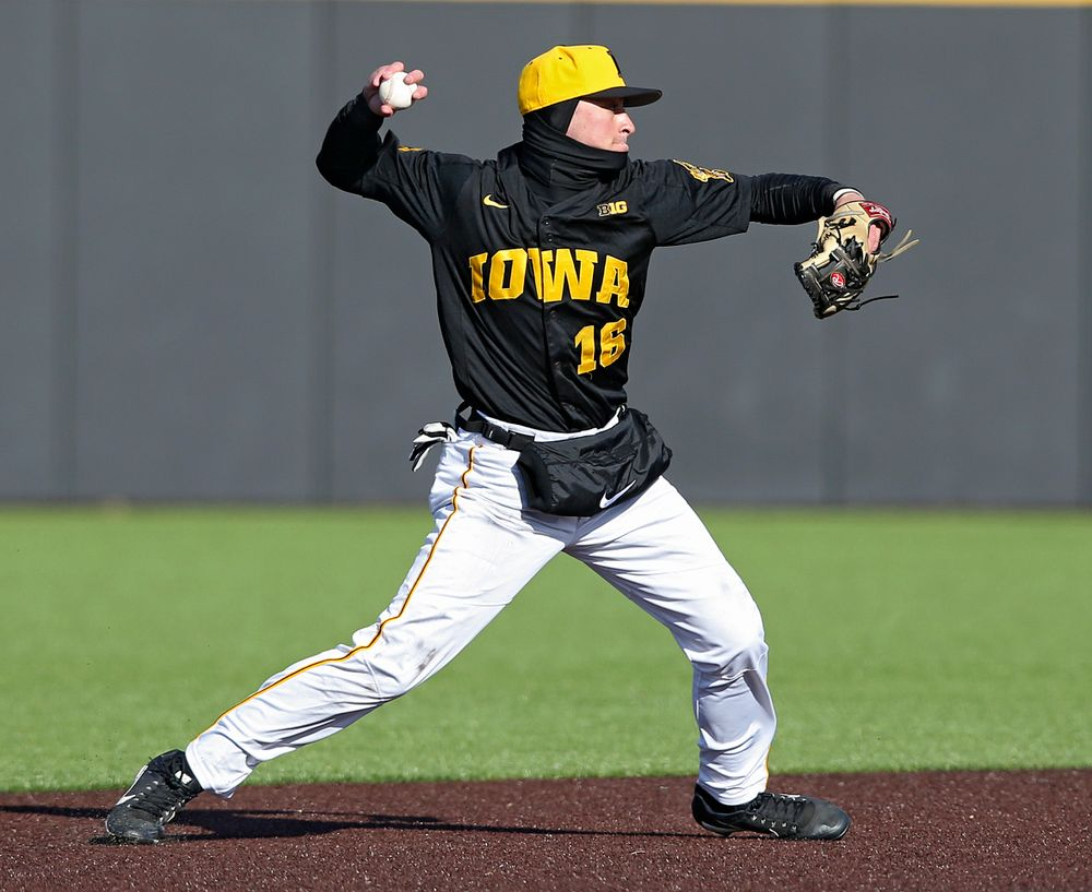 Iowa Hawkeyes shortstop Tanner Wetrich (16) throws to first base for an out during the ninth inning of their game against Illinois at Duane Banks Field in Iowa City on Saturday, Mar. 30, 2019. (Stephen Mally/hawkeyesports.com)
