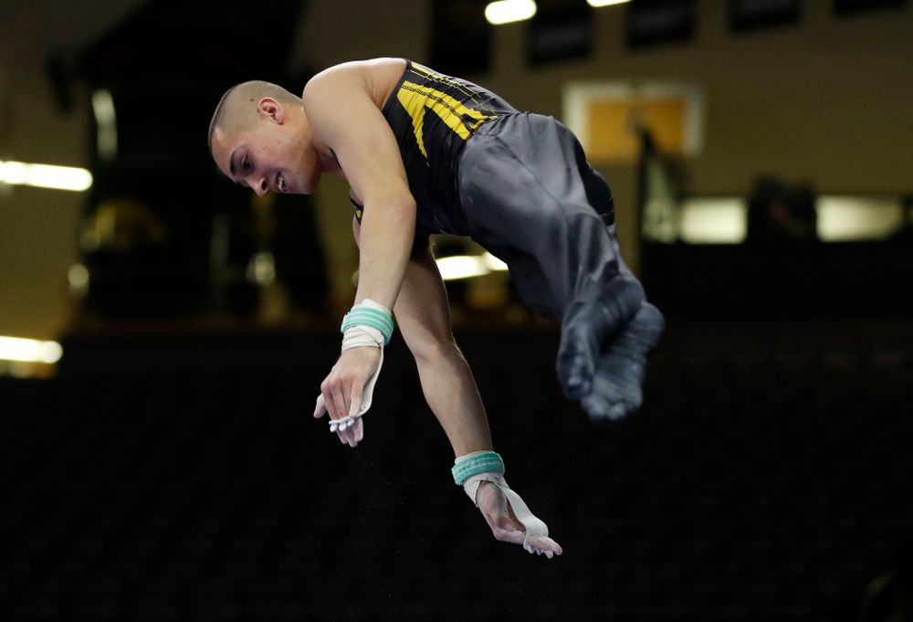 Iowa's Andrew Herrador competes on the high bar