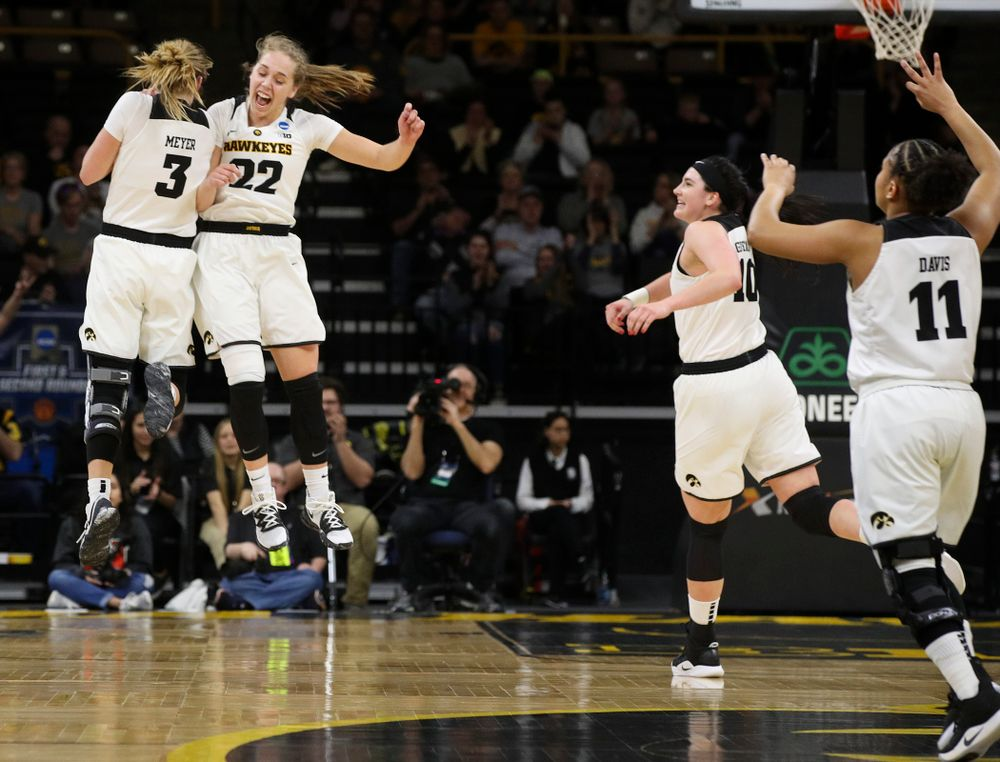 Iowa Hawkeyes guard Makenzie Meyer (3) and guard Kathleen Doyle (22) celebrate after Meyer's 3-pointer as forward Megan Gustafson (10) and guard Tania Davis (11) join during the first round of the 2019 NCAA Women's Basketball Tournament at Carver Hawkeye Arena in Iowa City on Friday, Mar. 22, 2019. (Stephen Mally for hawkeyesports.com)