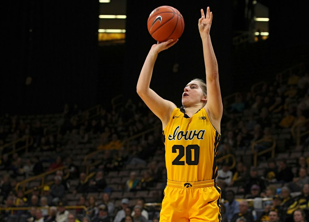 Iowa guard Kate Martin (20) puts up a shot during the third quarter of their game against Winona State at Carver-Hawkeye Arena in Iowa City on Sunday, Nov 3, 2019. (Stephen Mally/hawkeyesports.com)