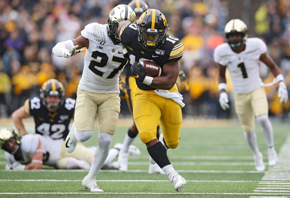 Iowa Hawkeyes running back Mekhi Sargent (10) on a run during the fourth quarter of their game at Kinnick Stadium in Iowa City on Saturday, Oct 19, 2019. (Stephen Mally/hawkeyesports.com)