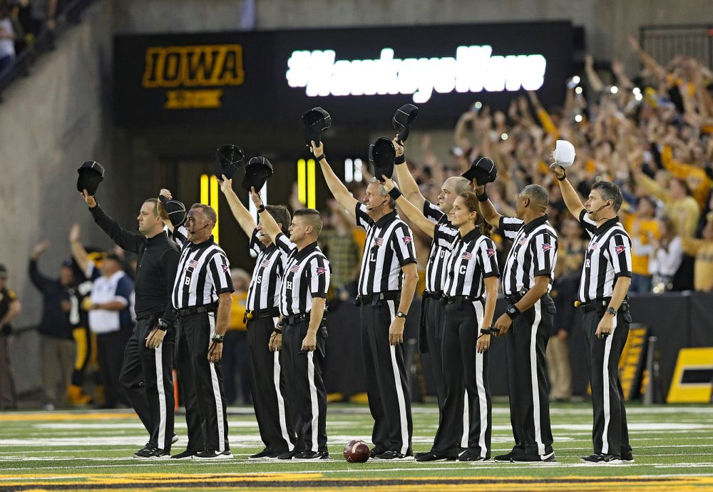 The officials wave to the University of Iowa Stead Family Children's Hospital between the first and second quarter of their game at Kinnick Stadium in Iowa City on Saturday, Aug 31, 2019. (Stephen Mally/hawkeyesports.com)