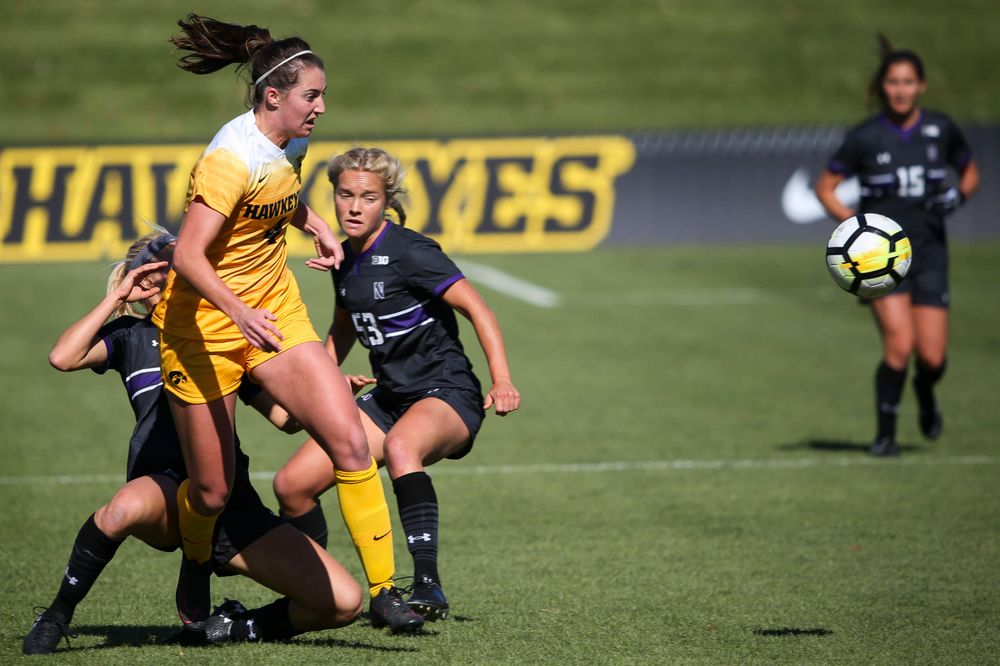 Iowa Hawkeyes forward Kaleigh Haus (4) passes the ball during a game against Northwestern at the Iowa Soccer Complex on October 21, 2018. (Tork Mason/hawkeyesports.com)