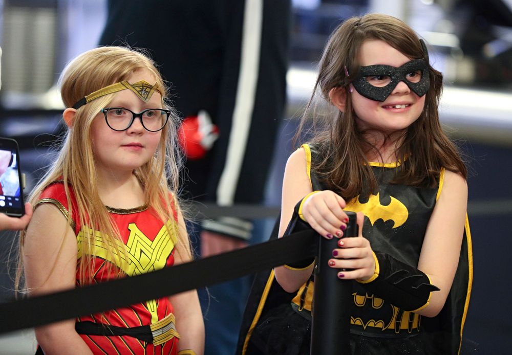 Two young fans wait in line on Superhero and Princess Day before the meet at Carver-Hawkeye Arena in Iowa City on Sunday, March 8, 2020. (Stephen Mally/hawkeyesports.com)
