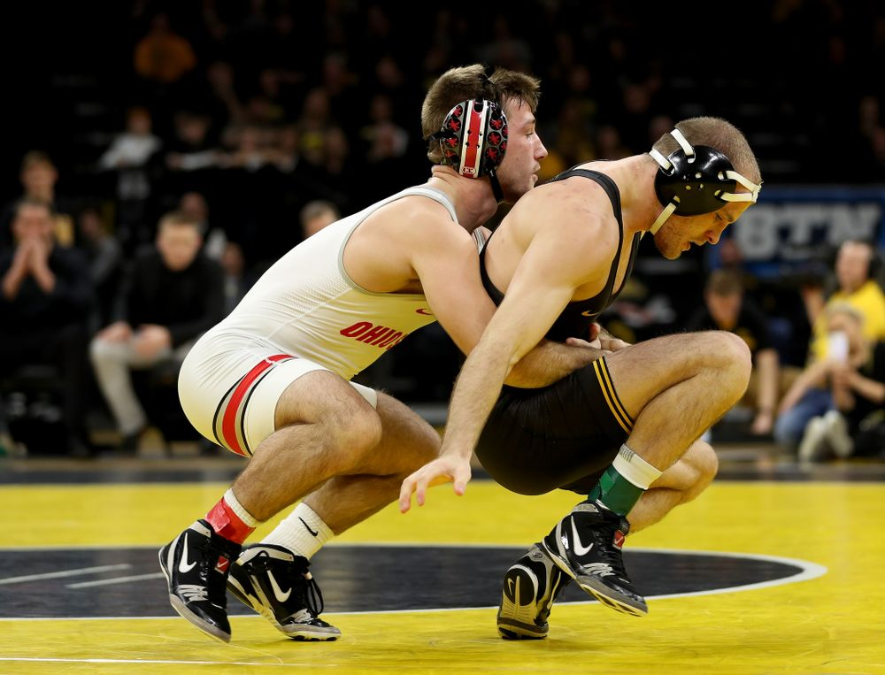 Iowa's Carter Happel wrestles Ohio State's Luke Pletcher at 141 pounds Friday, January 24, 2020 at Carver-Hawkeye Arena. Pletcher won the match with a 14-5. (Brian Ray/hawkeyesports.com)
