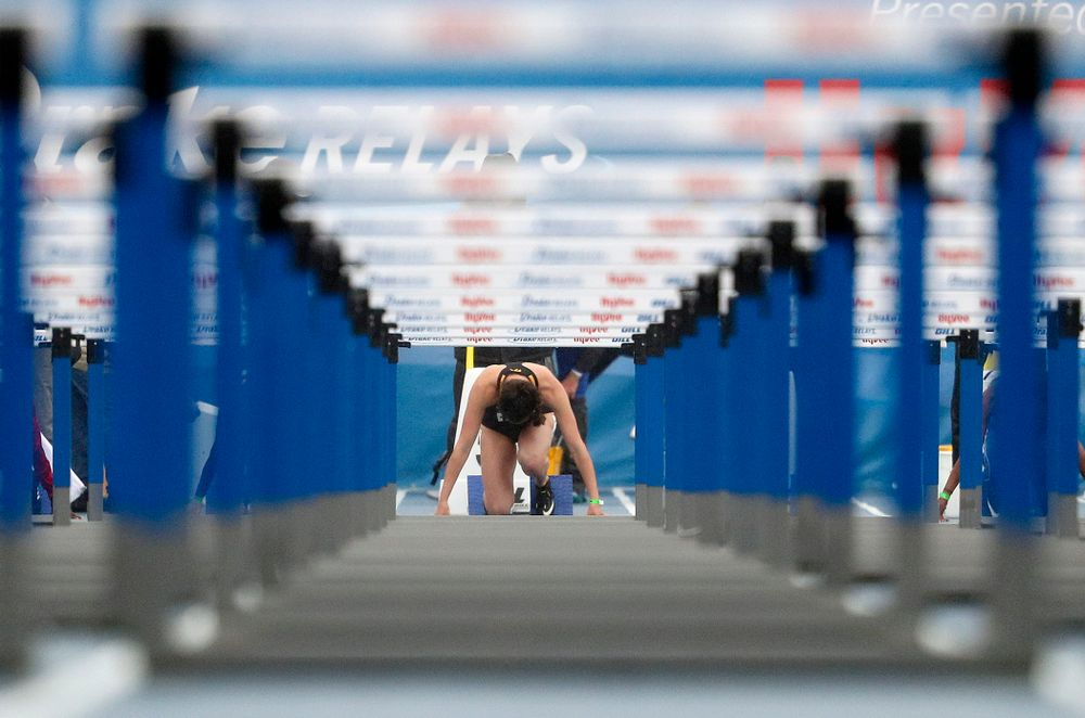 Iowa's Jenny Kimbro waits for the start in the blocks for the women's 100 meter hurdles event during the third day of the Drake Relays at Drake Stadium in Des Moines on Saturday, Apr. 27, 2019. (Stephen Mally/hawkeyesports.com)