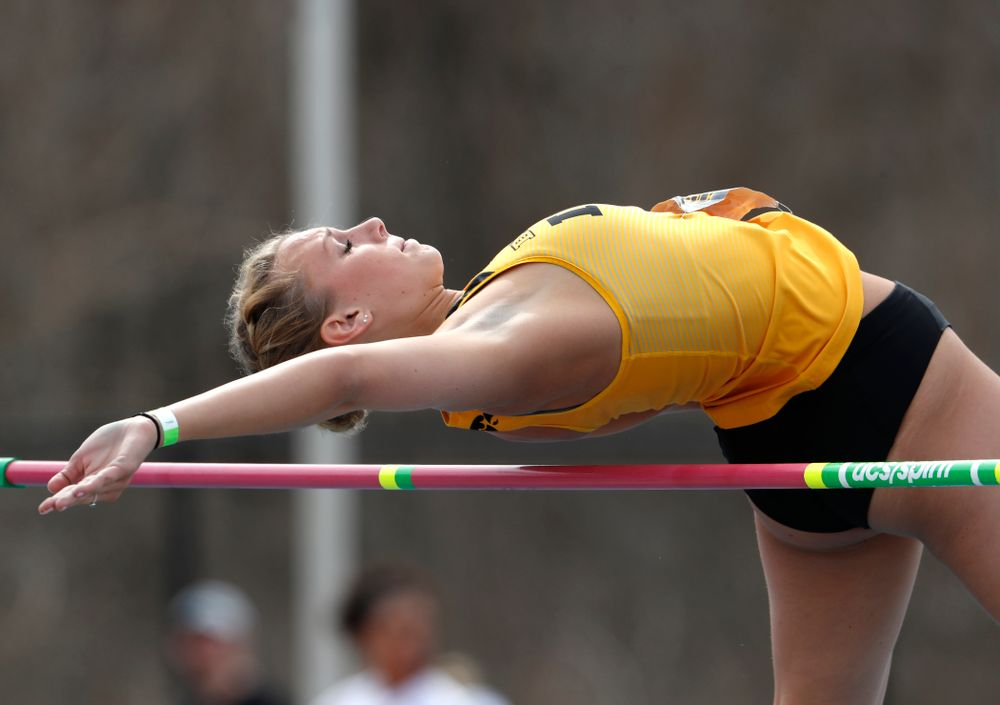 Iowa's Gillian Urycki competes in the high jump during the 2018 MUSCO Twilight Invitational  Thursday, April 12, 2018 at the Cretzmeyer Trac