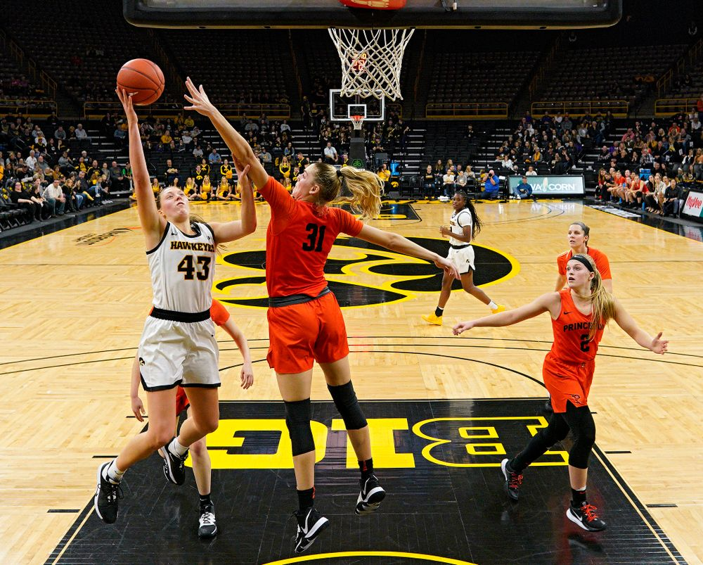 Iowa forward Amanda Ollinger (43) scores a basket during the third quarter of their overtime win against Princeton at Carver-Hawkeye Arena in Iowa City on Wednesday, Nov 20, 2019. (Stephen Mally/hawkeyesports.com)