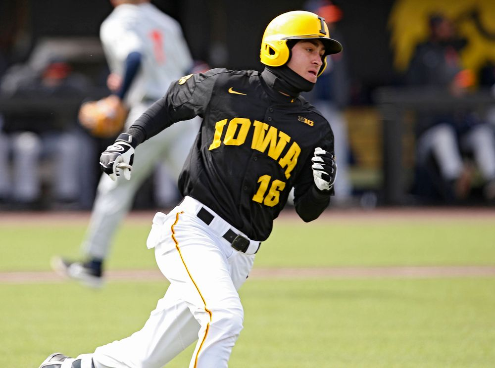 Iowa Hawkeyes shortstop Tanner Wetrich (16) runs after hitting a 2-RBI single during the second inning of their game against Illinois at Duane Banks Field in Iowa City on Saturday, Mar. 30, 2019. (Stephen Mally/hawkeyesports.com)