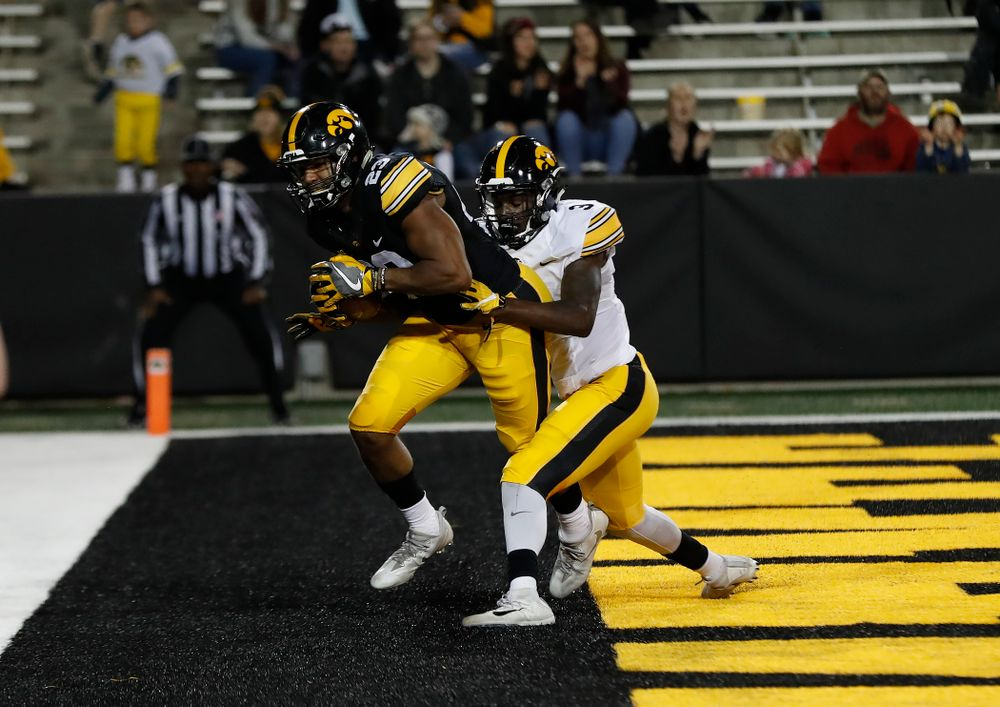 Iowa Hawkeyes wide receiver Dominique Dafney (23) and defensive back Trey Creamer (3) during their final spring practice Friday, April 20, 2018 at Kinnick Stadium. (Brian Ray/hawkeyesports.com)