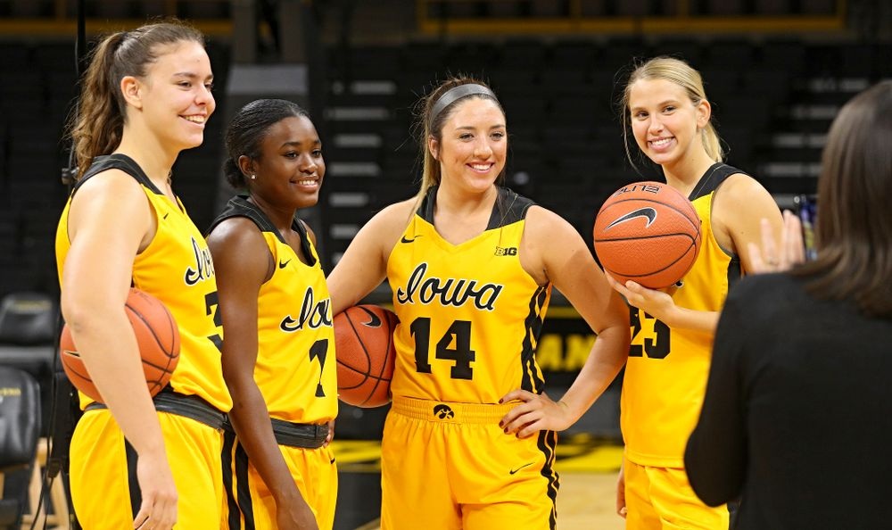 Iowa forward/center Paula Valiño Ramos (31), guard Tomi Taiwo (1), guard/forward McKenna Warnock (14), and forward Logan Cook (23) pose for a picture during Iowa Women's Basketball Media Day at Carver-Hawkeye Arena in Iowa City on Thursday, Oct 24, 2019. (Stephen Mally/hawkeyesports.com)