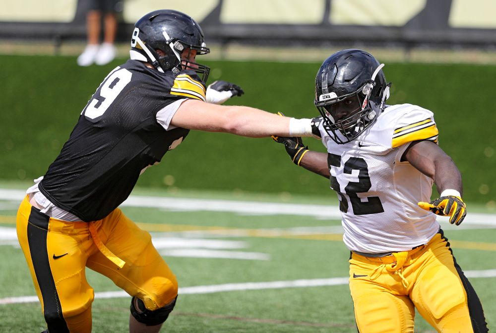 Iowa Hawkeyes offensive lineman Jack Plumb (79) runs a drill with linebacker Amani Jones (52) during Fall Camp Practice No. 11 at the Hansen Football Performance Center in Iowa City on Wednesday, Aug 14, 2019. (Stephen Mally/hawkeyesports.com)