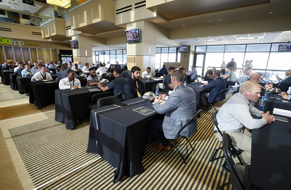 Former players meet with members of the current Hawkeye Football team during a networking event at Kinnick Stadium in Iowa City on Thursday, Jun 6, 2019. (Stephen Mally/hawkeyesports.com)