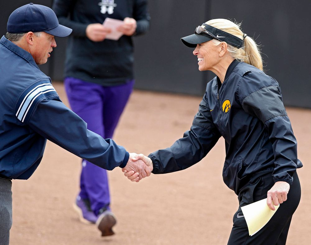Iowa Hawkeyes head coach Renee Gillispie shakes hands with an umpire before their Big Ten Conference softball game at Pearl Field in Iowa City on Friday, Mar. 29, 2019. (Stephen Mally/hawkeyesports.com)