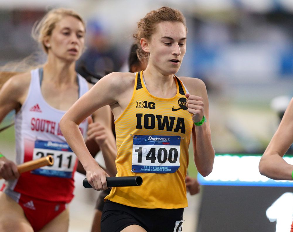 Iowa's Grace McCabe runs the women's 3200 meter relay event during the second day of the Drake Relays at Drake Stadium in Des Moines on Friday, Apr. 26, 2019. (Stephen Mally/hawkeyesports.com)