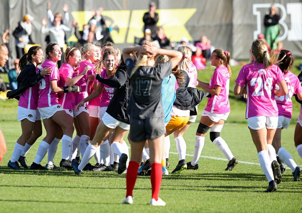 Iowa forward Samantha Tawharu (27) celebrates with her teammates after scoring the game winning golden goal during the second overtime of their match at the Iowa Soccer Complex in Iowa City on Sunday, Oct 27, 2019. (Stephen Mally/hawkeyesports.com)