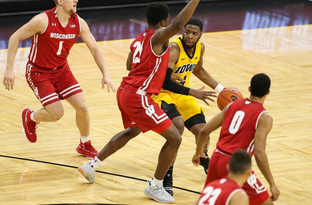 Iowa Hawkeyes guard Isaiah Moss (4) drives to the basket against Wisconsin on November 30, 2018 at Carver-Hawkeye Arena. (Tork Mason/hawkeyesports.com)