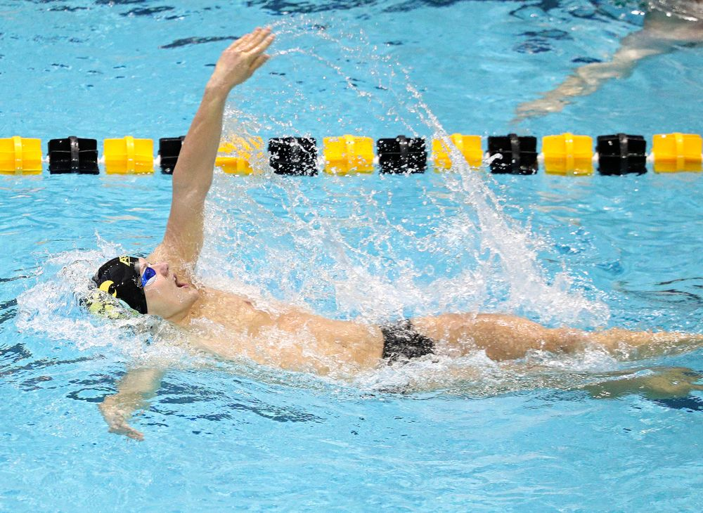 Iowa's Anze Fers Erzen swims the men's 100-yard backstroke event during their meet against Michigan State and Northern Iowa at the Campus Recreation and Wellness Center in Iowa City on Friday, Oct 4, 2019. (Stephen Mally/hawkeyesports.com)