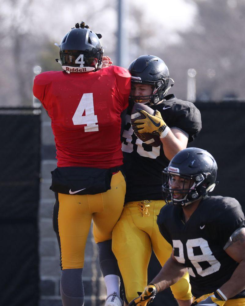 Iowa Hawkeyes tight end T.J. Hockenson (38) Iowa Hawkeyes quarterback Nathan Stanley (4)