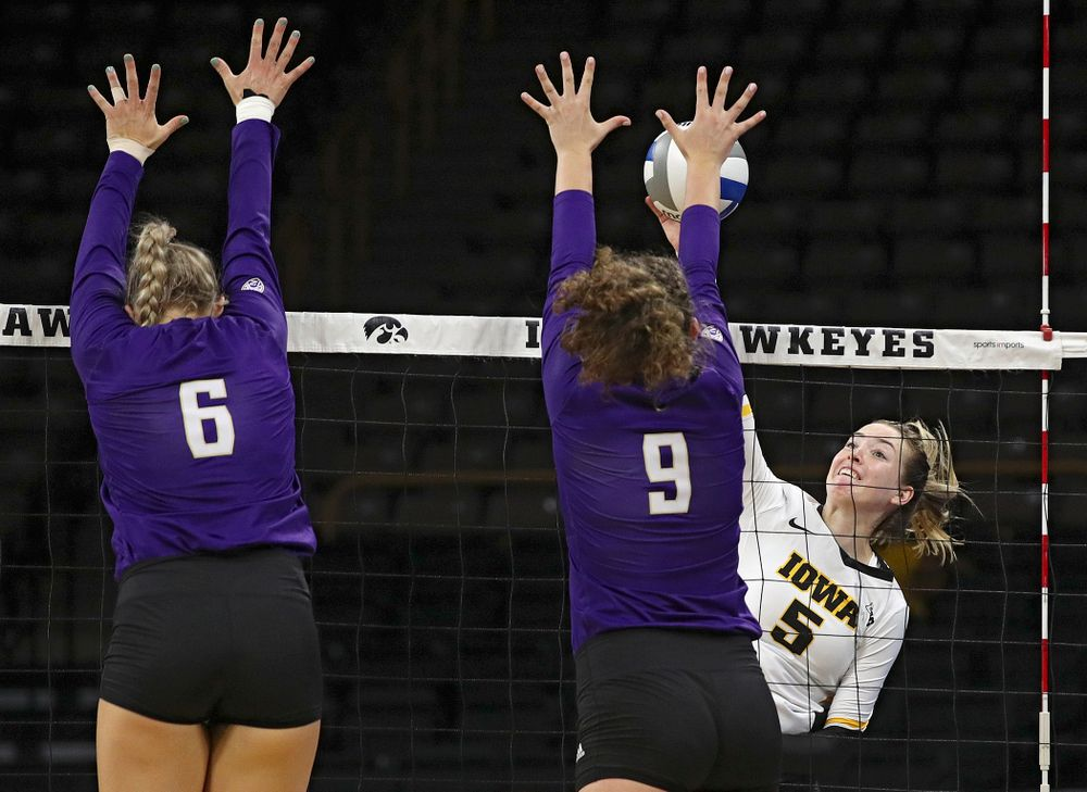 Iowa's Meghan Buzzerio (5) puts up a shot during their Big Ten/Pac-12 Challenge match at Carver-Hawkeye Arena in Iowa City on Saturday, Sep 7, 2019. (Stephen Mally/hawkeyesports.com)