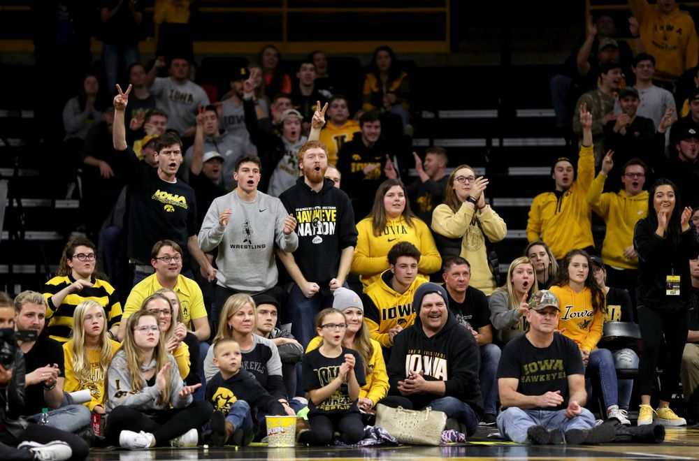 Fans cheer on IowaÕs Austin DeSanto as he wrestles WisconsinÕs  Seth Gross at 133 pounds Sunday, December 1, 2019 at Carver-Hawkeye Arena. DeSanto won the match 6-2. (Brian Ray/hawkeyesports.com)